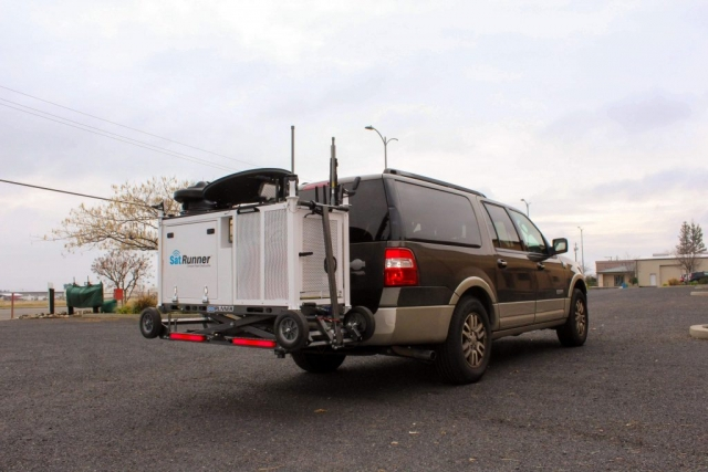 SatRunner loaded up on the back of a SUV - Perspective