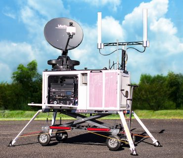 Deployed SatRunner Cell-On-Wheels in parking lot supplying Wi-Fi + Verizon Cellular