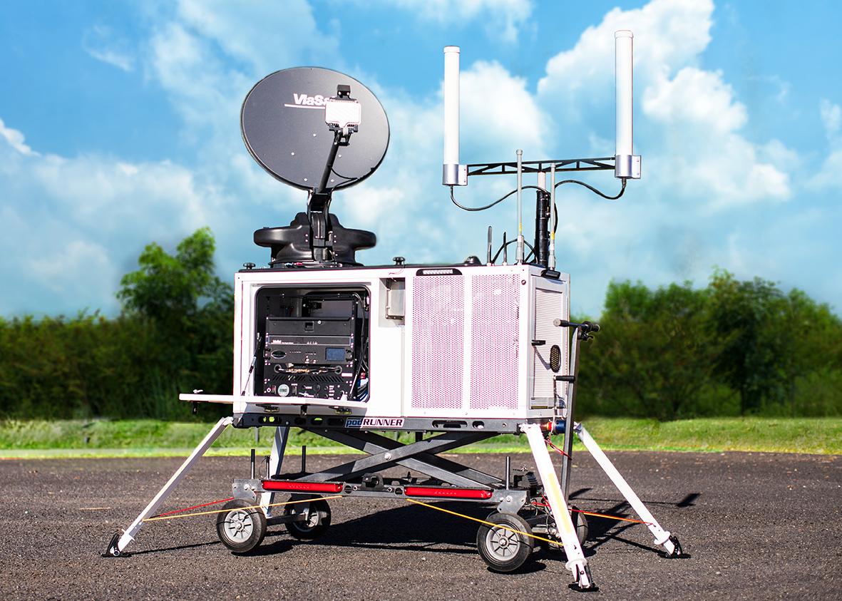 Deployed SatRunner Cell-On-Wheels in parking lot supplying Wi-Fi + Verizon Cellular